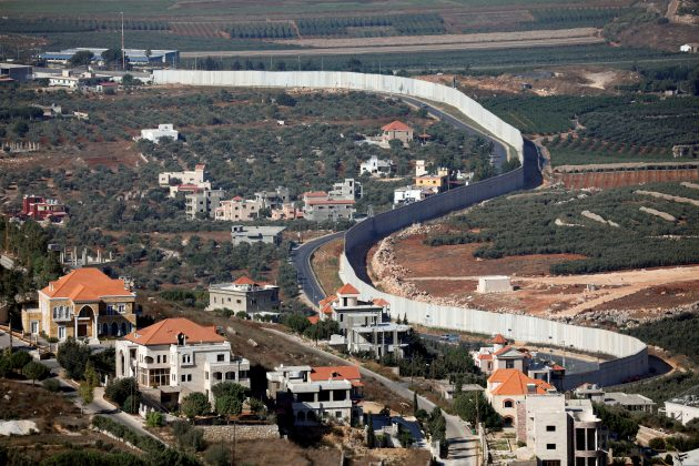FILE PHOTO: A general view picture shows the Lebanese village of Adaisseh on the left-hand-side of the Israel-Lebanon border, as seen from Kibbutz Misgav Am in northern Israel August 26, 2019. REUTERS/Amir Cohen/File Photo