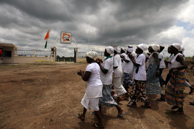 Women in procession dance outside a slavery memorial site near the Bodo river in Kanga Nianze village, in Tiassale, Ivory Coast, July 21, 2019. REUTERS/Luc Gnago