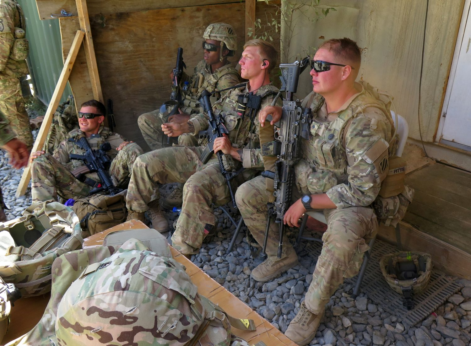 FILE PHOTO: U.S. military advisers from the 1st Security Force Assistance Brigade sit at an Afghan National Army base in Maidan Wardak province, Afghanistan August 6, 2018. REUTERS/James Mackenzie/File Photo