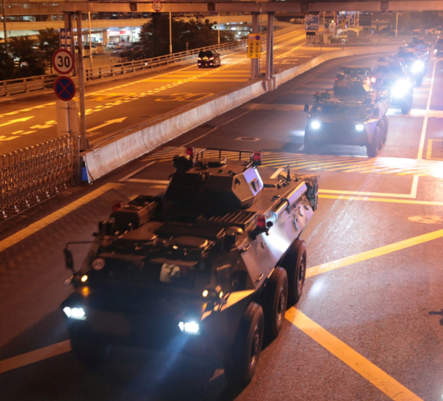 Military vehicles of the Chinese People's Liberation Army (PLA) pass Huanggang Port for a routine troop rotation in Hong Kong, August 29, 2019. Xinhua via REUTERS