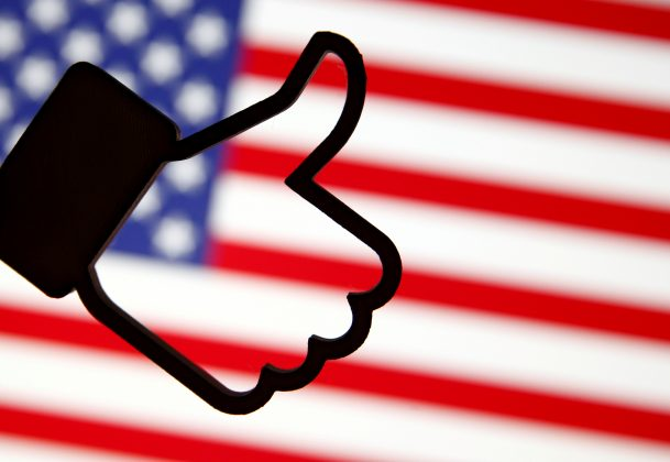FILE PHOTO: A 3D-printed Facebook Like symbol is displayed in front of a U.S. flag in this illustration taken, March 18, 2018. REUTERS/Dado Ruvic/Illustration/File Photo