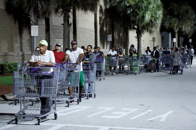 Shoppers wait in a long line for a Sam's Club store to open before sunrise, as people rushed to buy supplies ahead of the arrival of Hurricane Dorian in Kissimmee, Florida, U.S. August 30, 2019. REUTERS/Gregg Newton