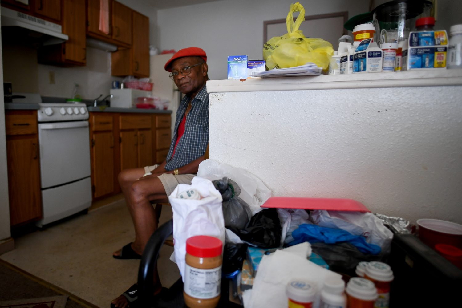 FILE PHOTO: Two days after Hurricane Irma, William James, 83, sits without power, food or water, in his room at Cypress Run, an assisted living facility, in Immokalee, Florida, U.S., September 12, 2017. REUTERS/Bryan Woolston/File Photo