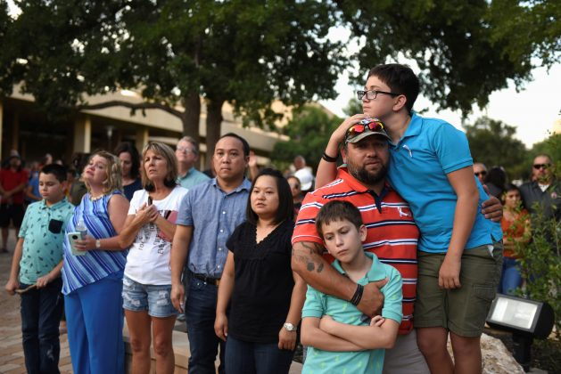 People gather for a vigil following Saturday's shooting in Odessa, Texas, U.S. September 1, 2019. REUTERS/Callaghan O'Hare