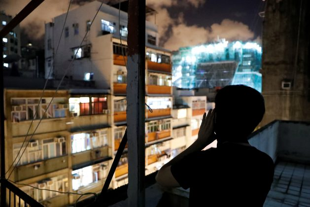 Choco Chu, 23, shouts slogan from his rooftop at Sham Shui Po in Hong Kong, China, August 29, 2019. REUTERS/Tyrone Siu