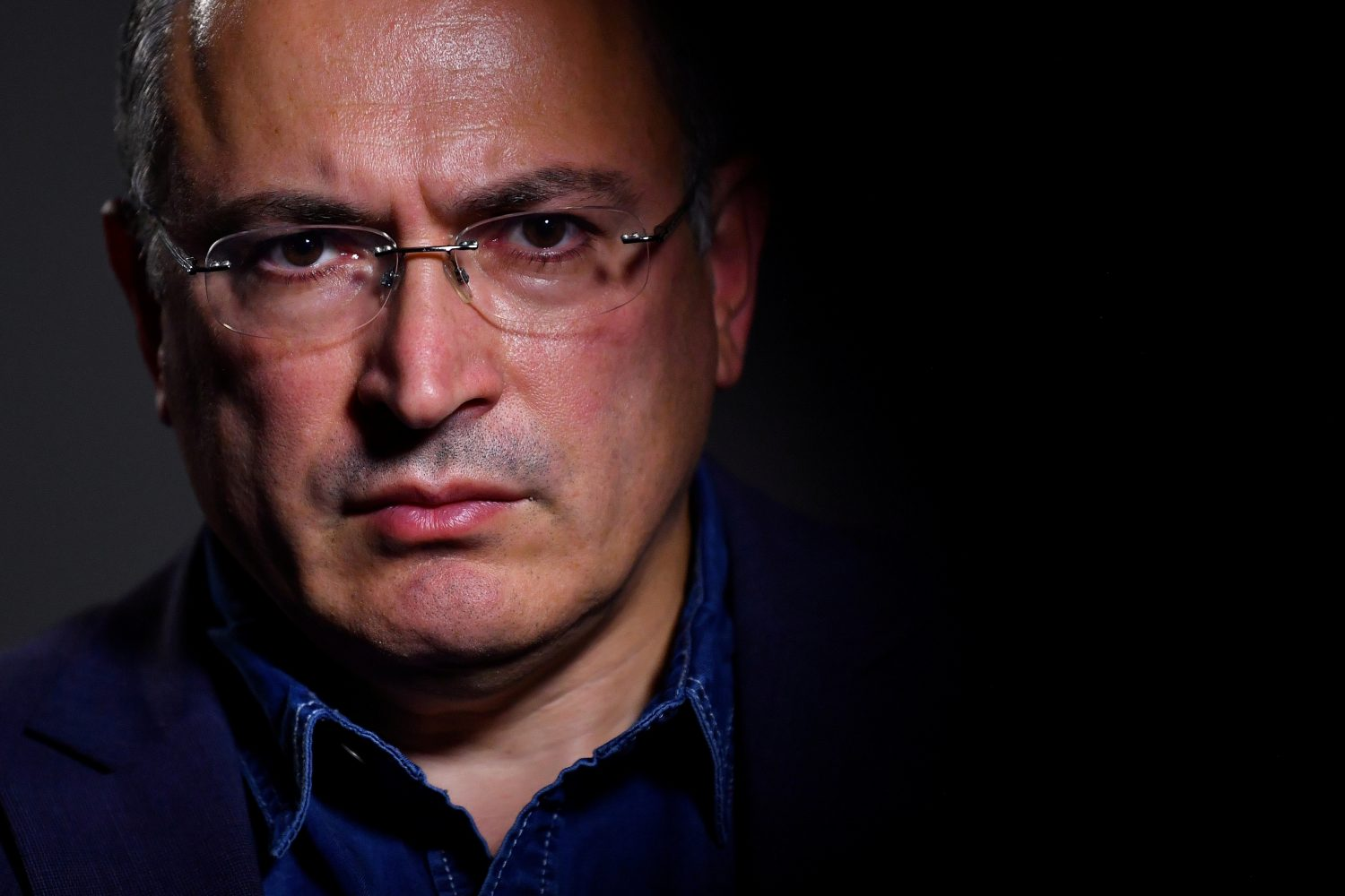 FILE PHOTO: Mikhail Khodorkovsky, a former oil tycoon who fell foul of Vladimir Putin's Kremlin, is seen during an interview with Reuters at his office in central London, Britain, August 13, 2018. REUTERS/Dylan Martinez/File Photo