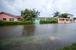Houses line a flooded street after the effects of Hurricane Dorian arrived in Nassau, Bahamas, September 2, 2019. REUTERS/John Marc Nutt