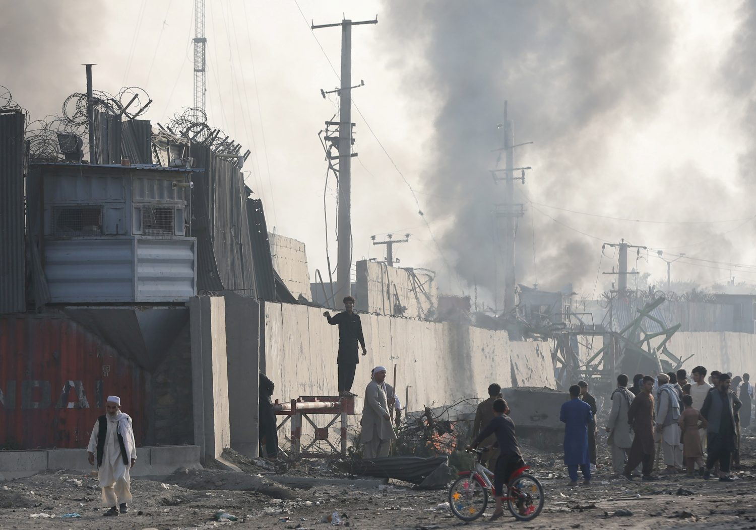 Angry Afghan protesters burn tires and shout slogans at the site of a blast in Kabul, Afghanistan September 3, 2019. REUTERS/Omar Sobhani