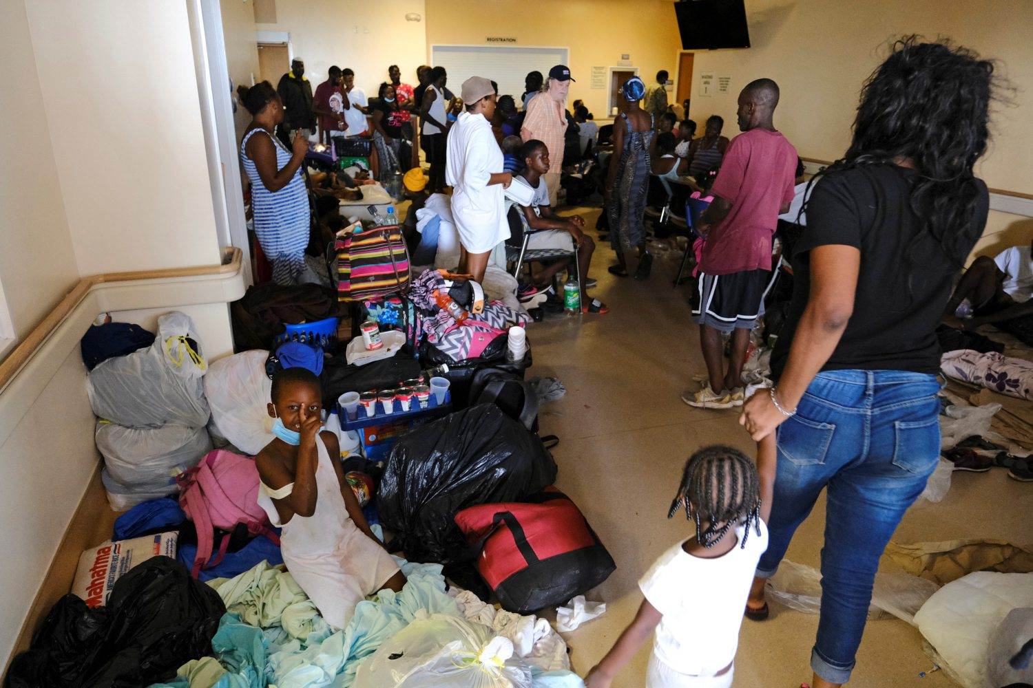 Patients and their families crowd the entrance of the Marsh Harbour Medical Clinic in the aftermath of Hurricane Dorian on the Great Abaco island town of Marsh Harbour, Bahamas, September 4, 2019. REUTERS/Dante Carrer