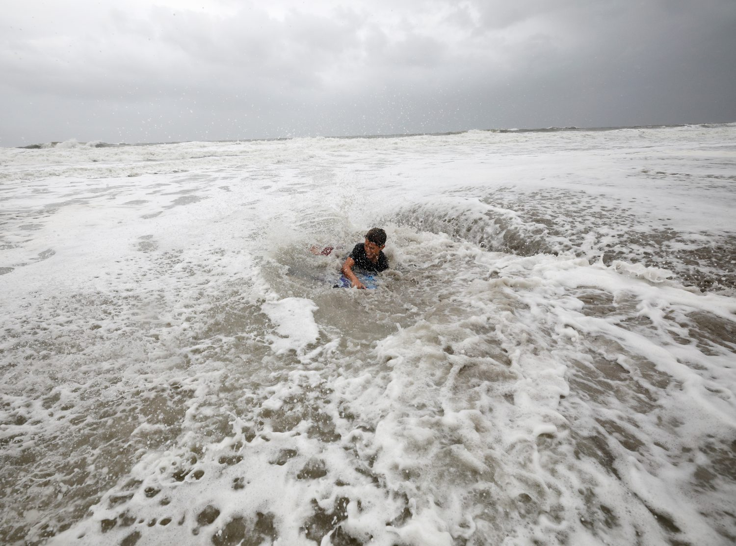 Nathan Piper, 11, is swamped by increasingly rough waves while body surfing as Hurricane Dorian approaches, in Carolina Beach, North Carolina, U.S., September 5, 2019. REUTERS/Jonathan Drake