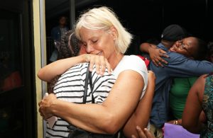 FILE PHOTO: Families react as they are reunited after a church group was evacuated from the Abaco Islands after Hurricane Dorian made landfall in Nassau, Bahamas September 4, 2019. Picture taken September 4, 2019. REUTERS/John Marc Nutt