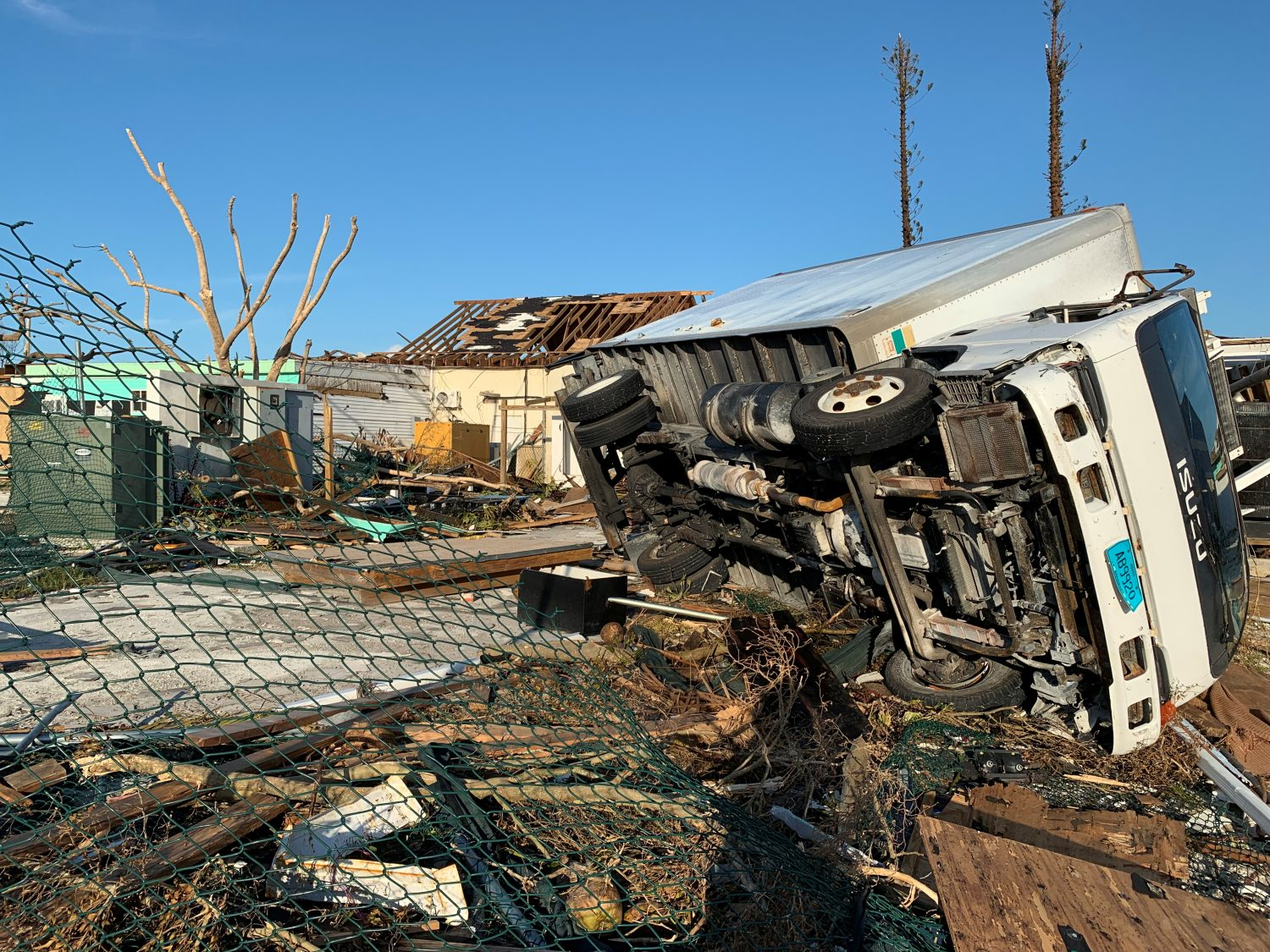 A truck sits on its side following landfall by Hurricane Dorian at an undisclosed location in the Bahamas in this International Federation of Red Cross and Red Crescent Societies photo released on September 6, 2019. Courtesy International Federation of Red Cross and Red Crescent Societies/Handout via REUTERS