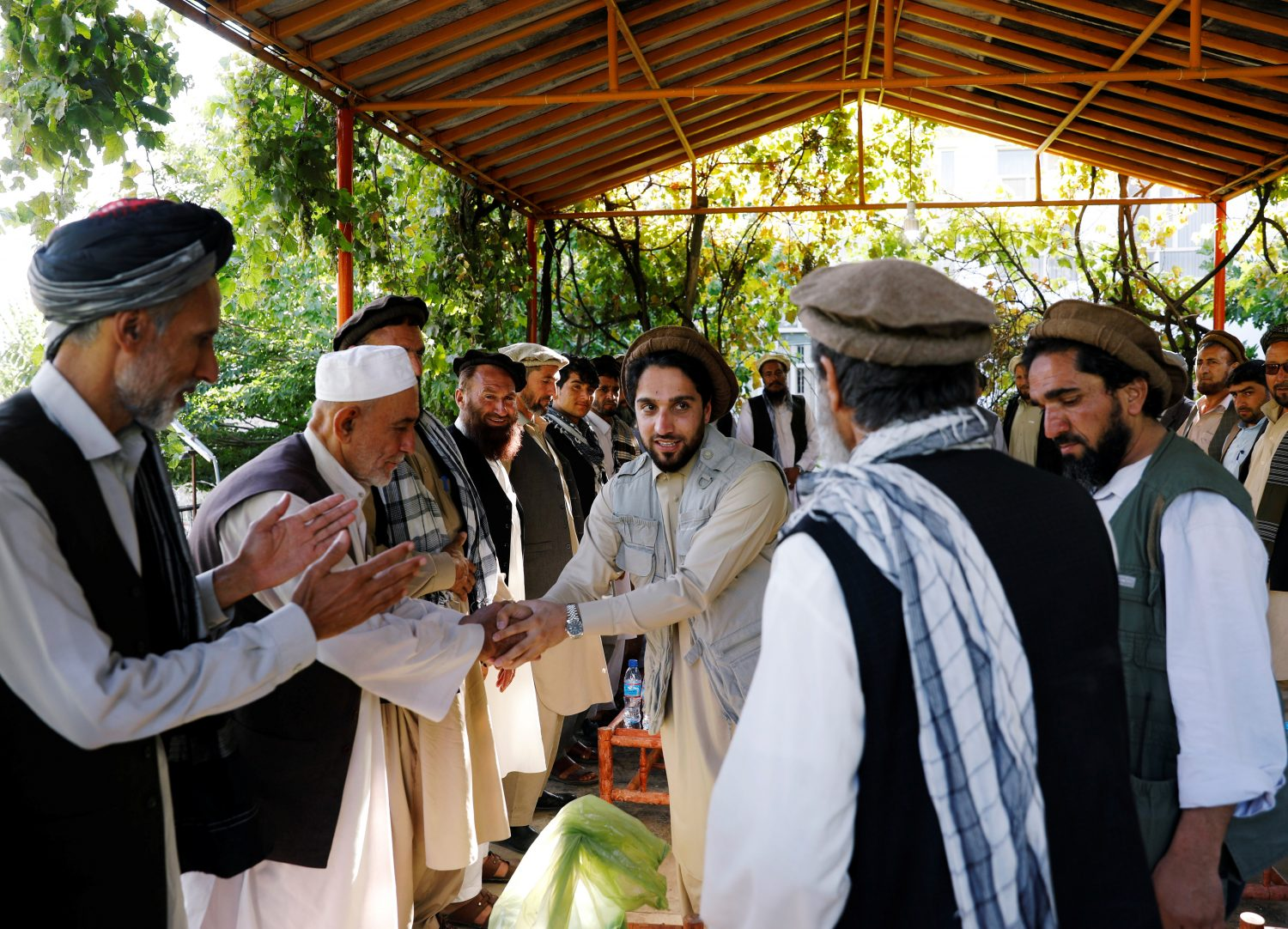 Ahmad Massoud, son of the slain hero of the anti-Soviet resistance, Ahmad Shah Massoud, shakes hands with his supporters at his house in Bazarak, Panjshir province Afghanistan September 5, 2019. Picture taken September 5, 2019.REUTERS/Mohammad Ismail
