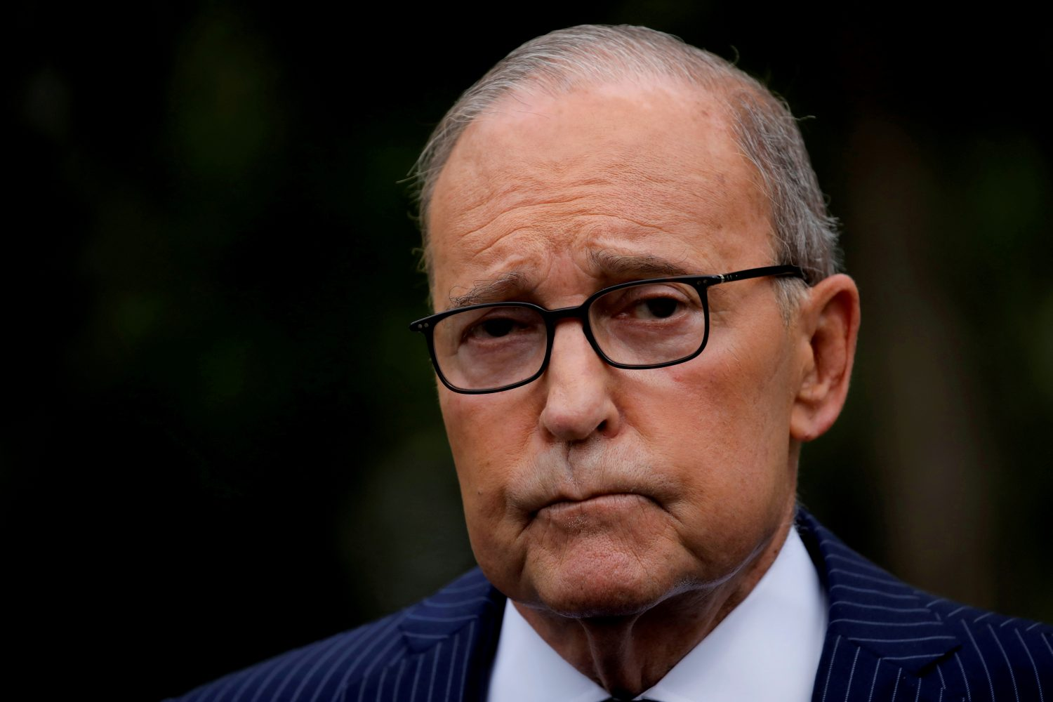 FILE PHOTO: White House chief economic adviser Larry Kudlow talks with reporters on the driveway outside the West Wing of the White House in Washington, U.S. August 2, 2019. REUTERS/Carlos Barria
