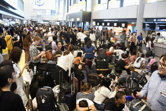 Passengers are stranded after railways and subway operators suspended their services due to Typhoon Faxai, at Narita airport in Narita, east of Tokyo, Japan September 9, 2019, in this photo taken by Kyodo. Mandatory credit Kyodo/via REUTERS