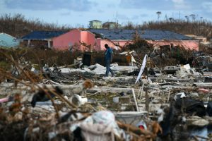A man searches for belongings amongst debris in a destroyed neighborhood in the wake of Hurricane Dorian in Marsh Harbour, Great Abaco, Bahamas, September 8, 2019. REUTERS/Loren Elliott