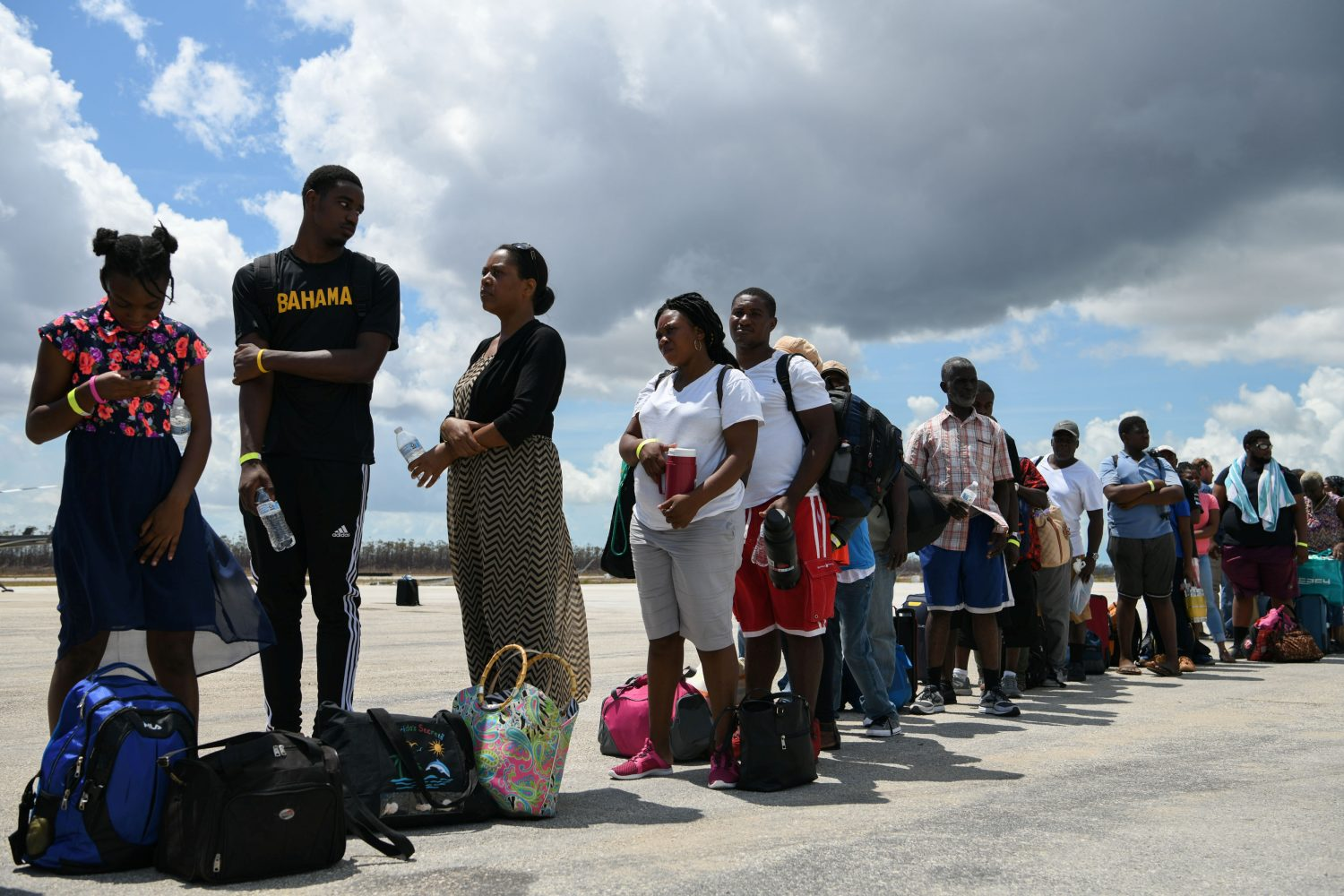 Abaco residents are evacuated from the island at the airport in the wake of Hurricane Dorian in Marsh Harbour, Great Abaco, Bahamas, September 8, 2019. REUTERS/Loren Elliott
