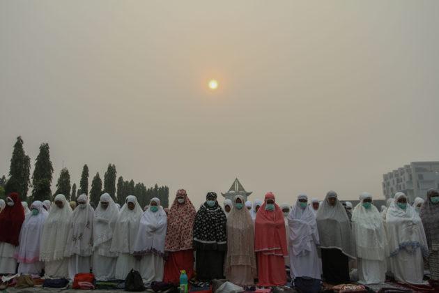 Indonesian Muslim women pray for rain during a long drought season and haze in Pekanbaru, Riau province, Indonesia, September 11, 2019 in this photo taken by Antara Foto. Antara Foto/Rony Muharrman/ via REUTERS