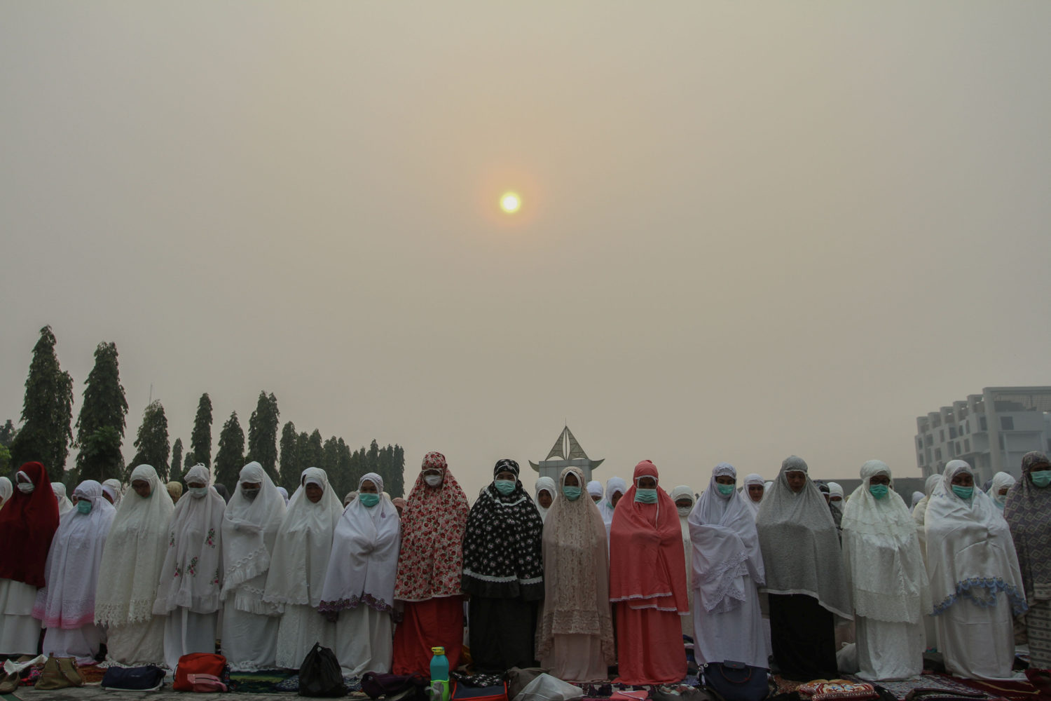 Indonesian Muslim women pray for rain during a long drought season and haze in Pekanbaru, Riau province, Indonesia, September 11, 2019 in this photo taken by Antara Foto. Antara Foto/Rony Muharrman/ via REUTERS