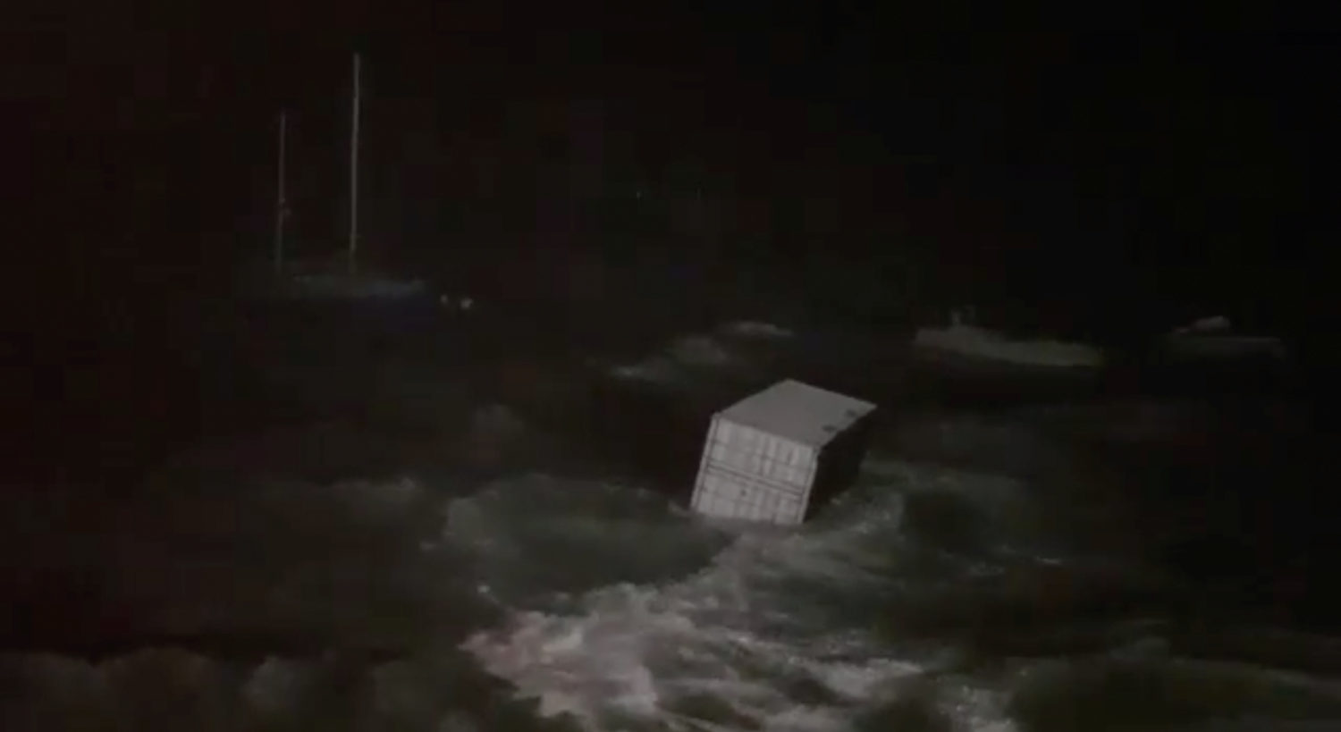 FILE PHOTO: A cargo container floats at sea during storm in Hamilton, Bermuda September 18, 2019 in this still picture obtained from social media video. ALEXANDRE DOWLING via REUTERS
