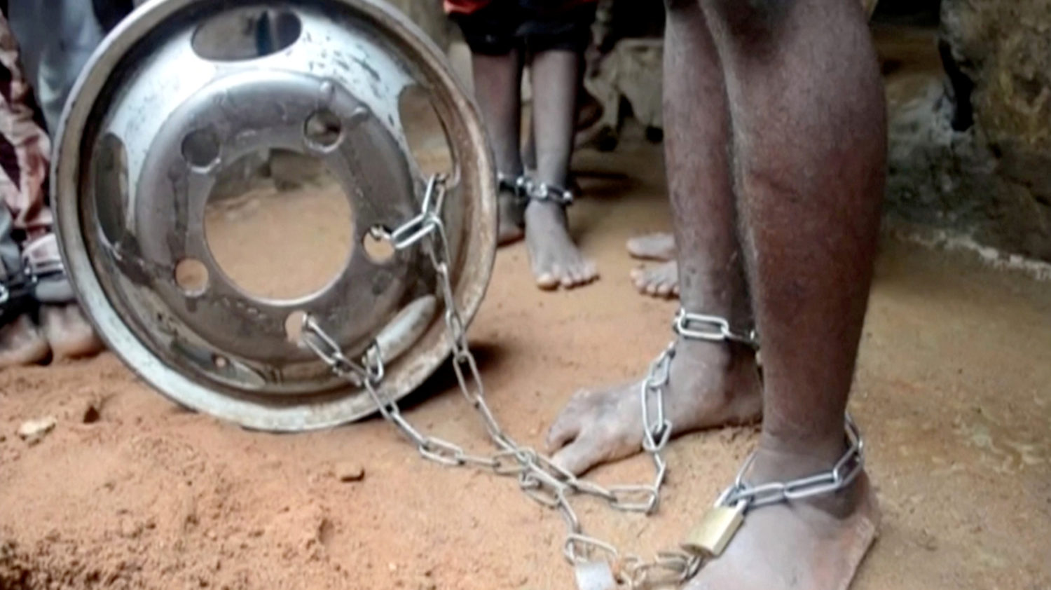 People with chained legs are pictured after being rescued from a building in the northern city of Kaduna, Nigeria September 26, 2019, in this grab obtained from a video. TELEVISION CONTINENTAL/Reuters TV via REUTERS