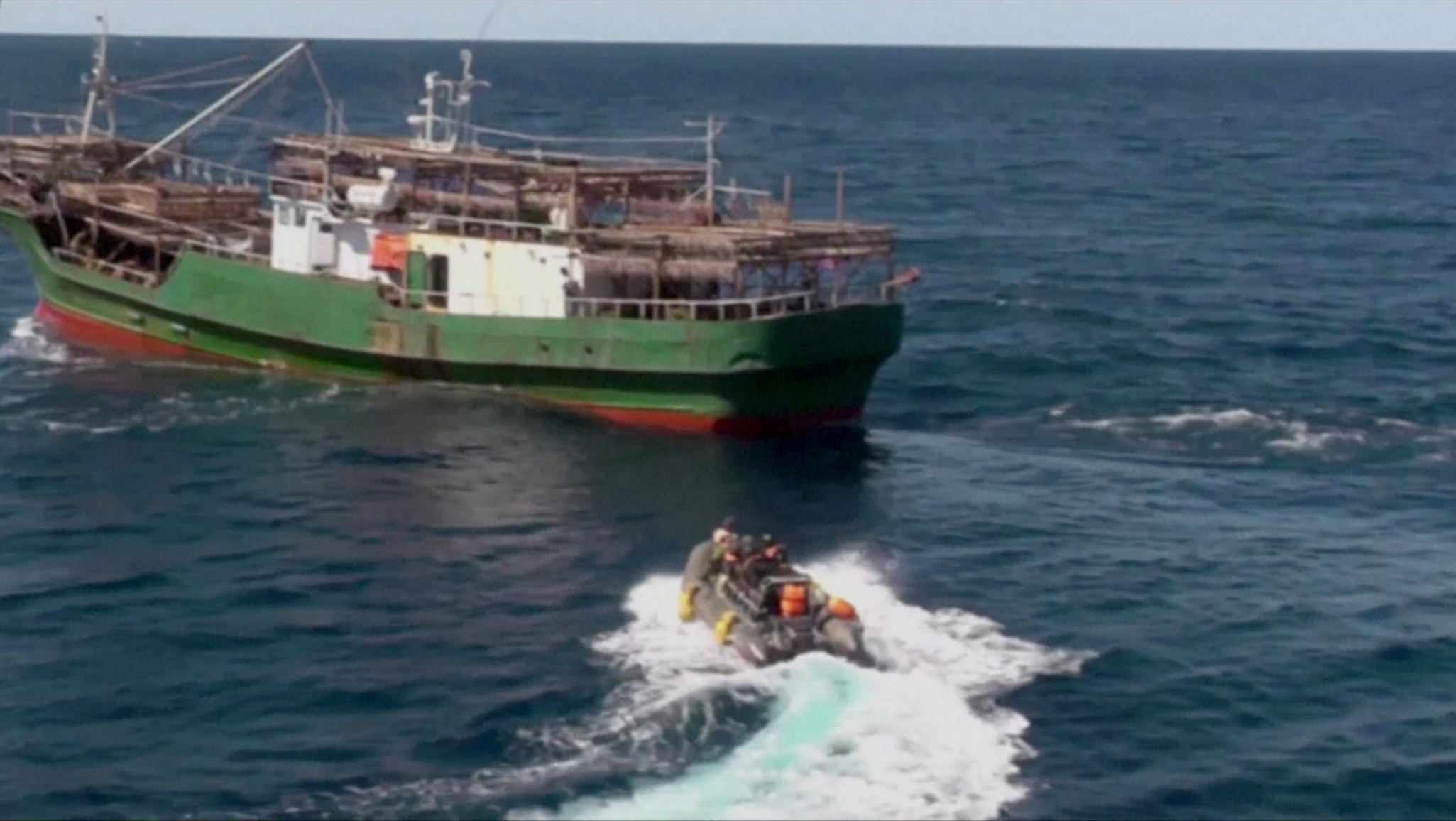 A still image taken from video footage shows a boat with Russian border guards sailing towards a North Korean vessel to detain it and crew members for poaching in waters that Moscow considers its exclusive economic zone, released by Russia's Federal Security Service on September 27, 2019. Federal Security Service/Handout via REUTERS