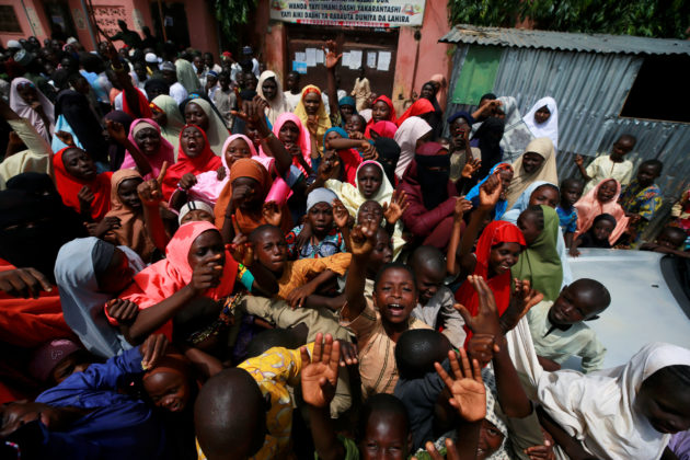 People protest outside the building where hundreds of men and boys were rescued from captivity by police in Kaduna, Nigeria September 28, 2019. REUTERS/Afolabi Sotunde