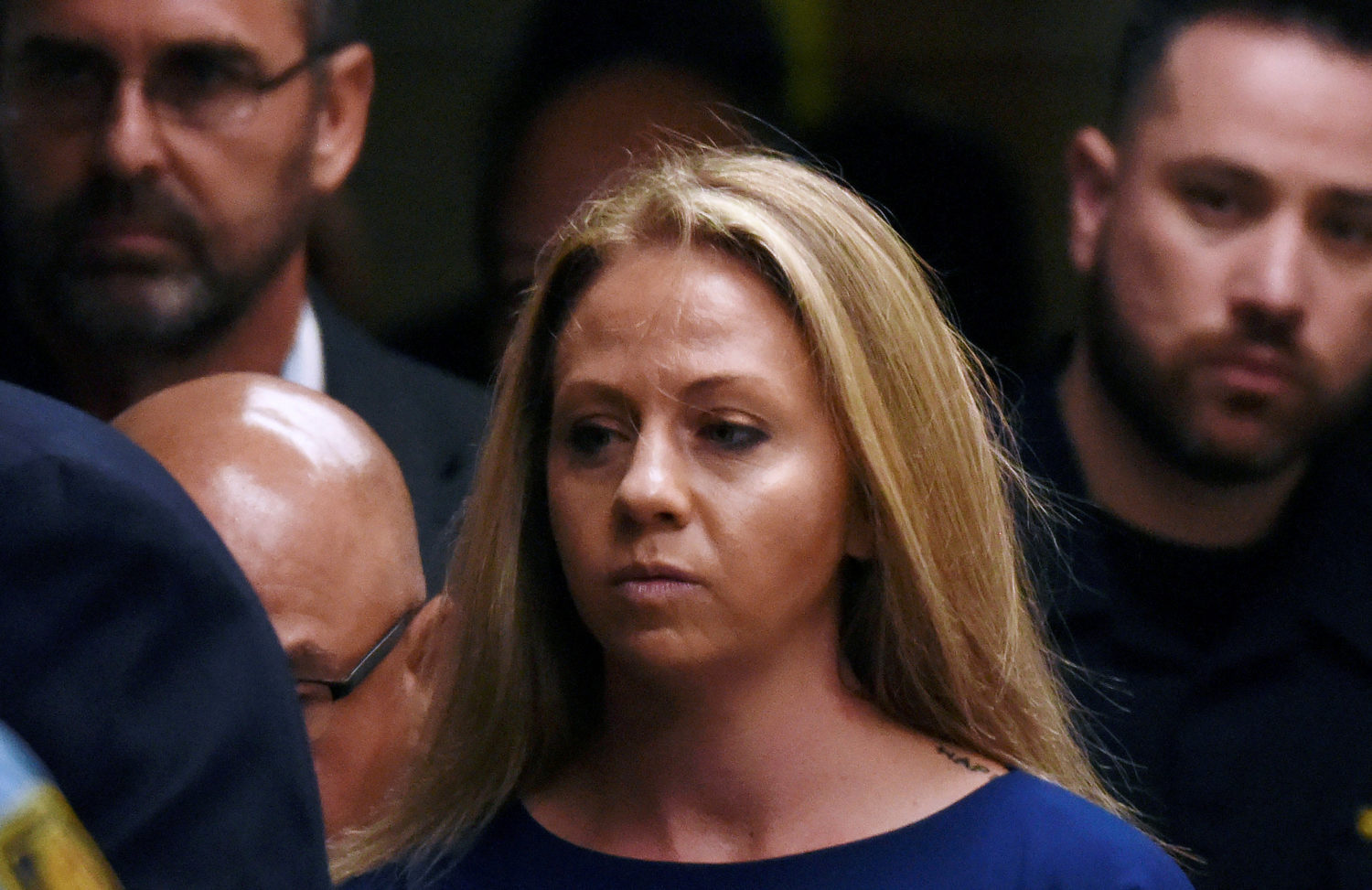 FILE PHOTO: Amber Guyger, who is charged in the killing of Botham Jean in his own home, arrives on the first day of the trial in Dallas, Texas, U.S., September 23, 2019. REUTERS/Jeremy Lock/File Photo