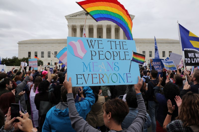 LGBTQ activists and supporters hold a rally outside the U.S. Supreme Court as it hears arguments in a major LGBT rights case on whether a federal anti-discrimination law that prohibits workplace discrimination on the basis of sex covers gay and transgender employees in Washington, U.S., October 8, 2019. REUTERS/Jonathan Ernst
