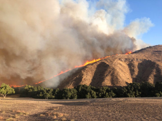 Fire is seen in Simi Valley, California, U.S. October 30, 2019, in this social media image. Courtesy of Twitter @415FirePhoto/Social Media via REUTERS.