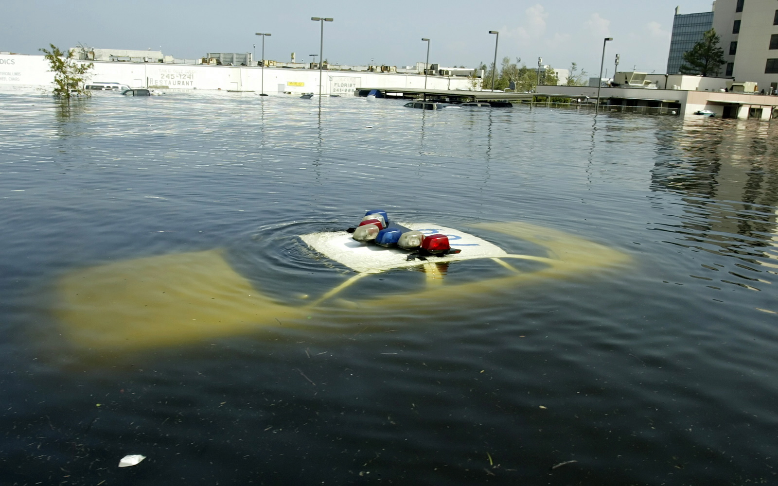 A police car is submerged in New Orleans East August 31, 2005 after Hurricane Katrina hit the area. Authorities struggled on Wednesday to evacuate thousands of people from hurricane-battered New Orleans as food and water grew scarce and looters raided stores, [while U.S. President George W. Bush said it would take years to recover from the devastation.]