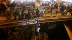 Anti-goverment protesters trapped inside Hong Kong Polytechnic University abseil onto a highway and escape before being forced to surrender during a police besiege of the campus in Hong Kong, China November 18, 2019. HK01/Handout via REUTERS