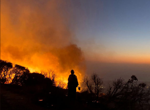 A firefighter battles the Cave fire in Los Padres National Forest near East Camino Cielo, California, U.S. November 25, 2019, in this picture obtained from social media. Mandatory credit Mike Eliason/Santa Barbara County Fire Department/via REUTERS