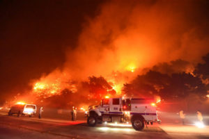 Firefighters battle flames off Highway 154 north of Santa Barbara, California, U.S. November 25, 2019, in this picture obtained from social media. Mandatory credit Mike Eliason/Santa Barbara County Fire Department/via REUTERS