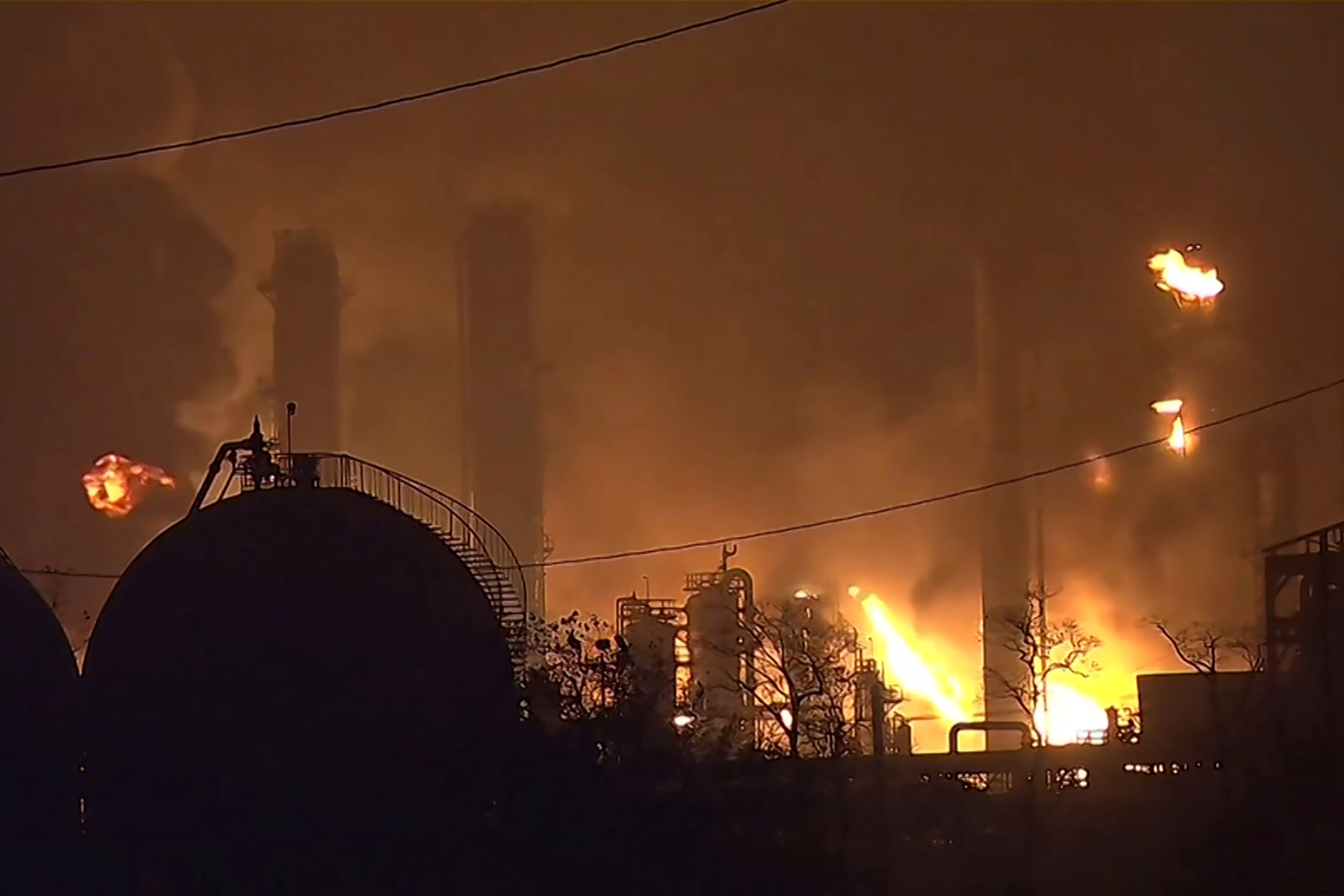 Flames rise over a petrochemical plant after an explosion in a still image from video in Port Neches, Texas, U.S. November 27, 2019. 12NewsNow.com via REUTERS.